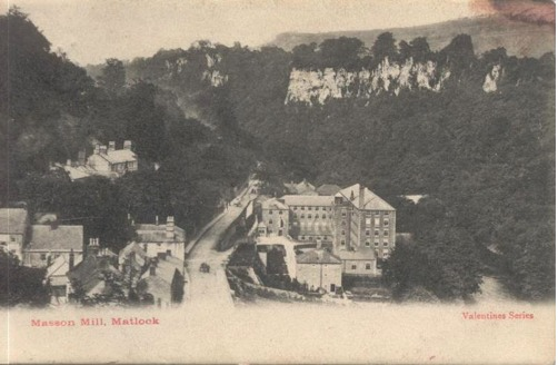 Sepia postcard of Masson Mill, with the cliffs of Matlock behind