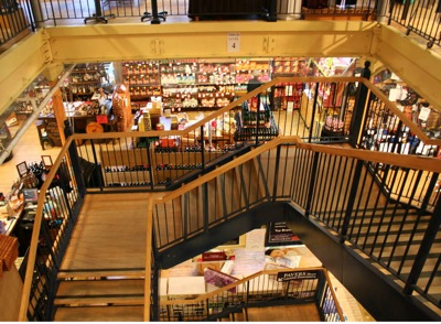 Spiral stairwell leading to lower floor shopping area