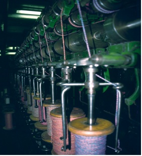 Spools of cotton being wound on a machine
